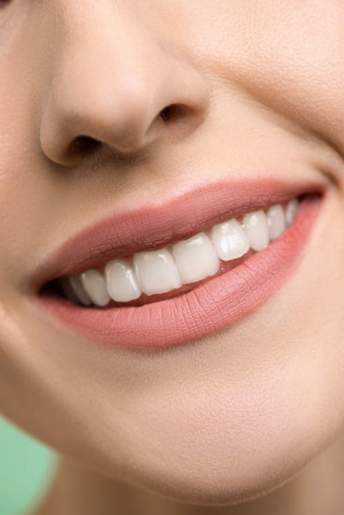 A close-up image of a person's smile.